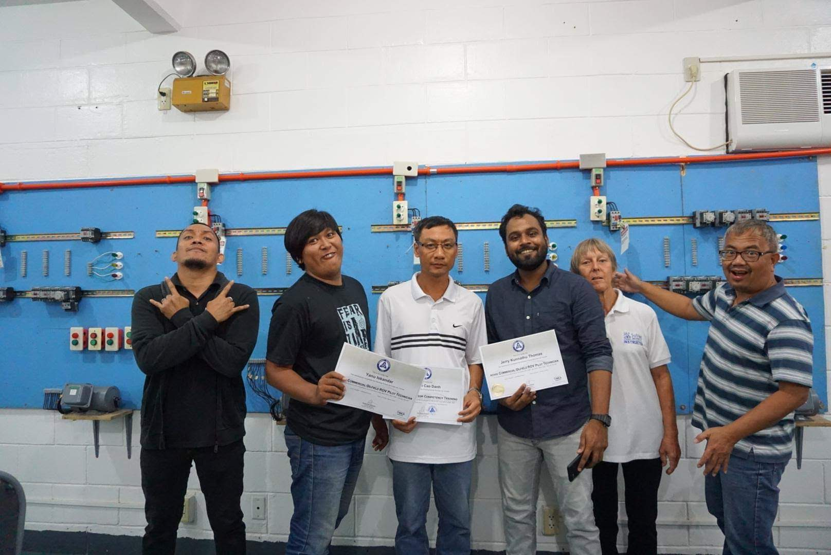ROV students posing with their certificates