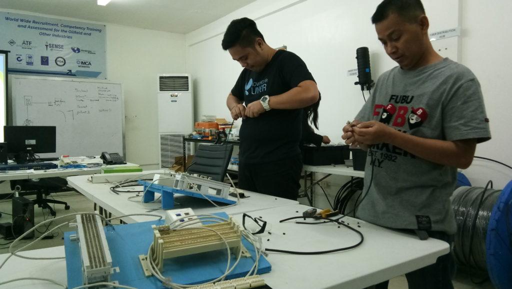 Subnet Services fiber optics training instructor during hands-on work