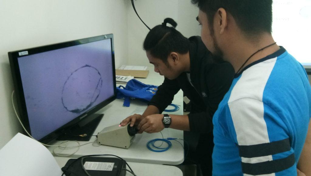 Subnet Services fiber optics training instructor during lab work