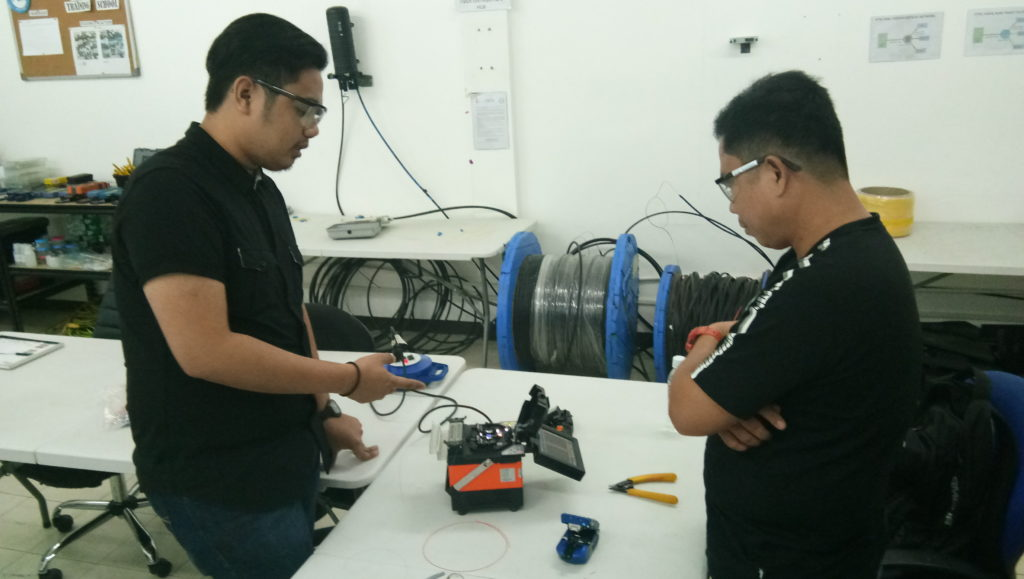 Subnet Services fiber optics training instructor giving tips to student